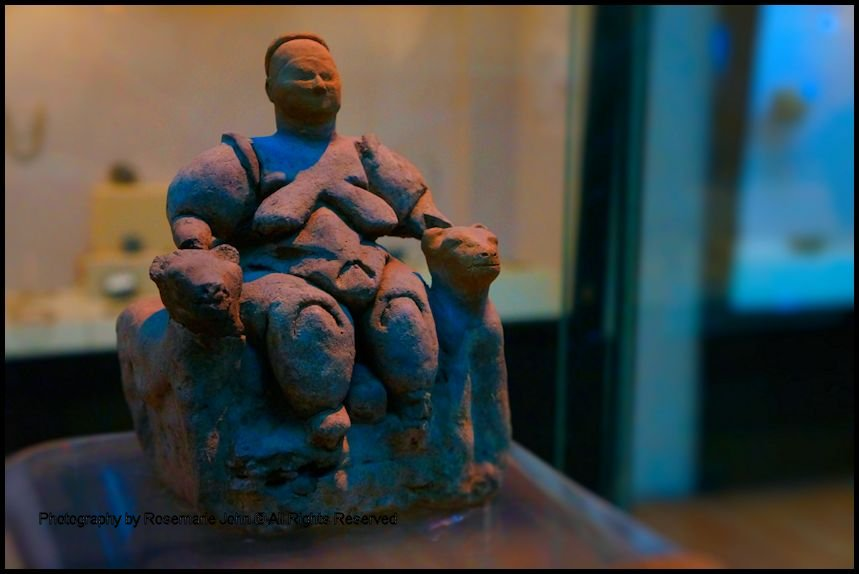 Goddess Figurine – With her large breasts and wide hips, this female figurine has been linked to both agriculture and fertility. Her seated position between two leopards, however, suggests she is a person of power. Look at the round shape resting between her legs. Is it a head of a child being born or a skull of a revered ancestor?