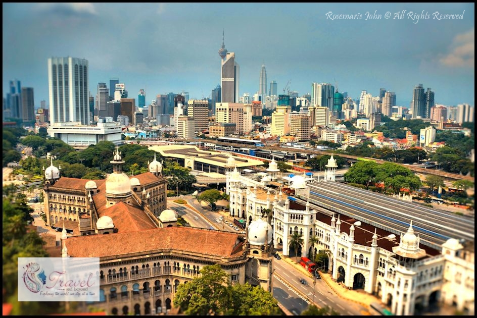 Kuala Lumpur skyline with the old railway station situated on the right...