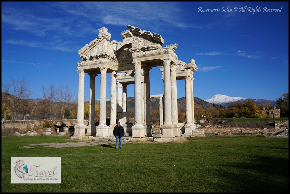 Joseph at the Monumental Gateway. Upon arrival to the ruins you will be greeted by the renovated Tetrapylon, a gateway of Corinthian style columns decorated with reliefs of the god Eros and goddess Nike.