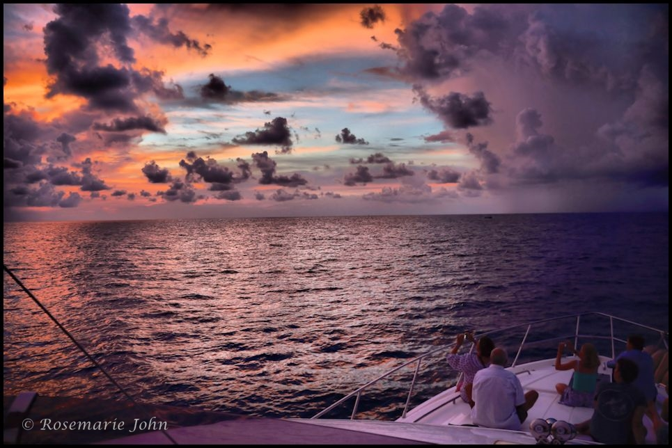 As the yacht turned, we saw orange hues of a very shy sun that evening.
