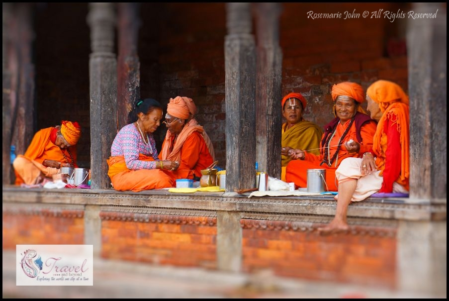 Sadhvis tying flowers together for offering in the temples